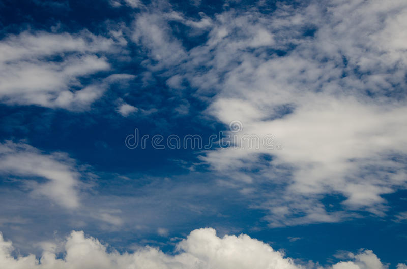 Clouds and deep blue sky. A lot of copyspace. Shot using CPL circular polarizing filter for deep blue colors stock images