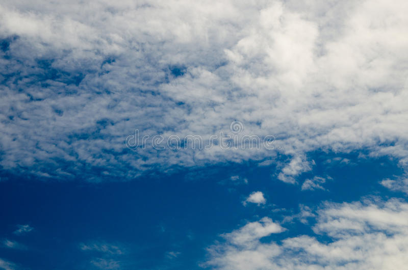 Clouds and deep blue sky. A lot of copyspace. Shot using CPL circular polarizing filter for deep blue colors royalty free stock images