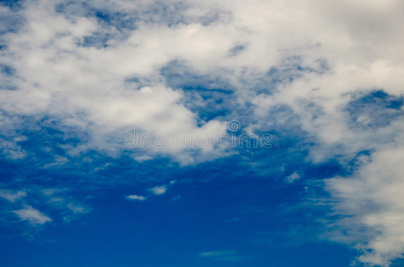 Clouds and deep blue sky. A lot of copyspace. Shot using CPL circular polarizing filter for deep blue colors royalty free stock image