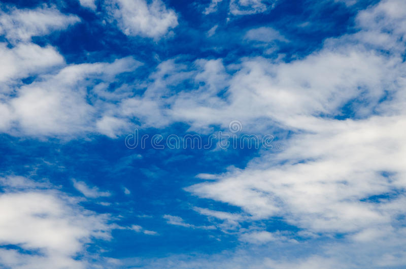 Clouds and deep blue sky. A lot of copyspace. Shot using CPL circular polarizing filter for deep blue colors royalty free stock photos