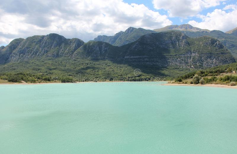 Clouds on the emerald lake royalty free stock photo