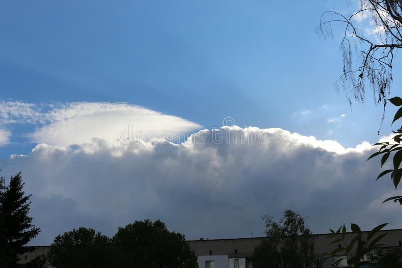Clouds in the evening sky fascinate. There are many of them, and they surprise with forms stock photography