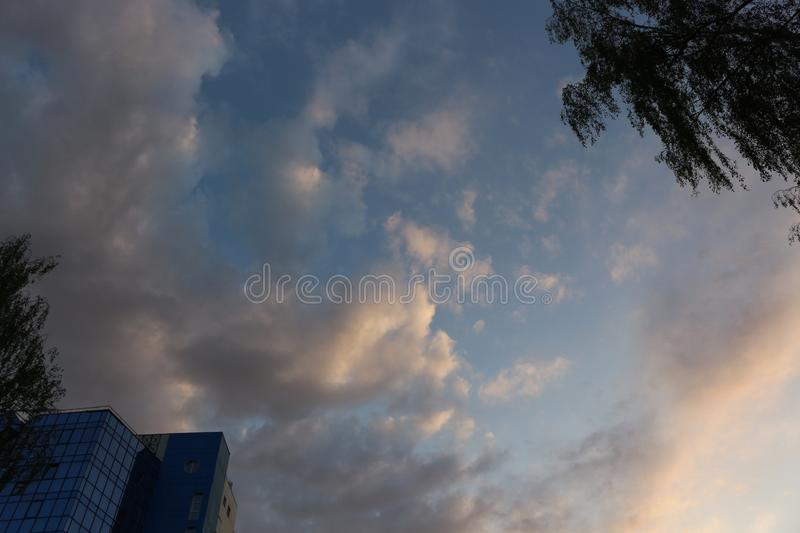 Clouds in the evening sky fascinate. There are many of them, and they surprise with forms royalty free stock images