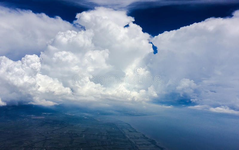 Clouds face on blue sky. stock image