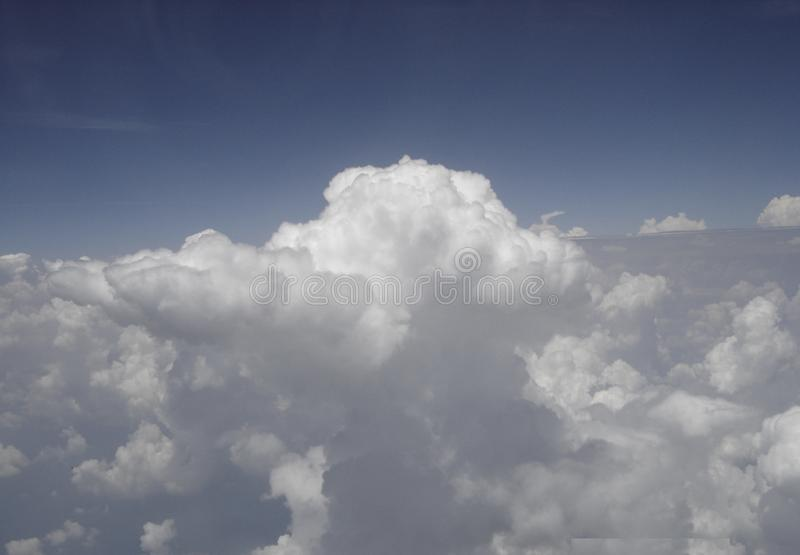 Clouds at 30,000 feet. Great shot of big cumulus clouds from the window of an airplane royalty free stock photography