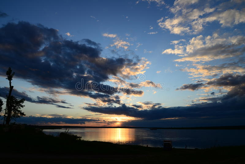 Sunset in russia, Siberia, evening, river, yenisei, water, lake, twilight royalty free stock images
