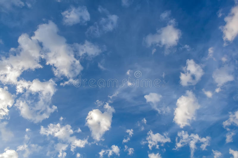 Clouds in the form of bizarre shapes on a blue sky. Clouds in the form of bizarre shapes on a bright blue sky royalty free stock image