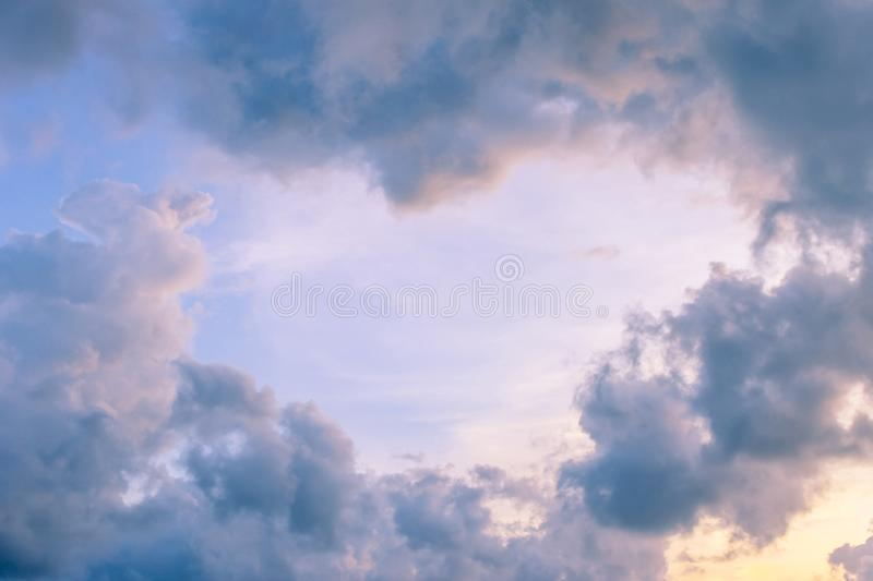Clouds in the form of a heart in the sky. Pink clouds in the form of a heart in the sky at sunset of the day royalty free stock image