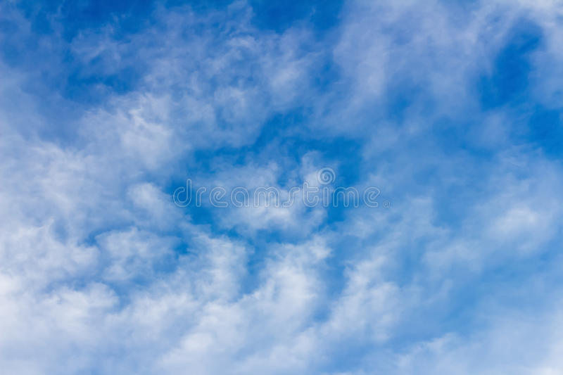 Clouds form a mosaic against the blue sky. Illustrate the general background royalty free stock photography
