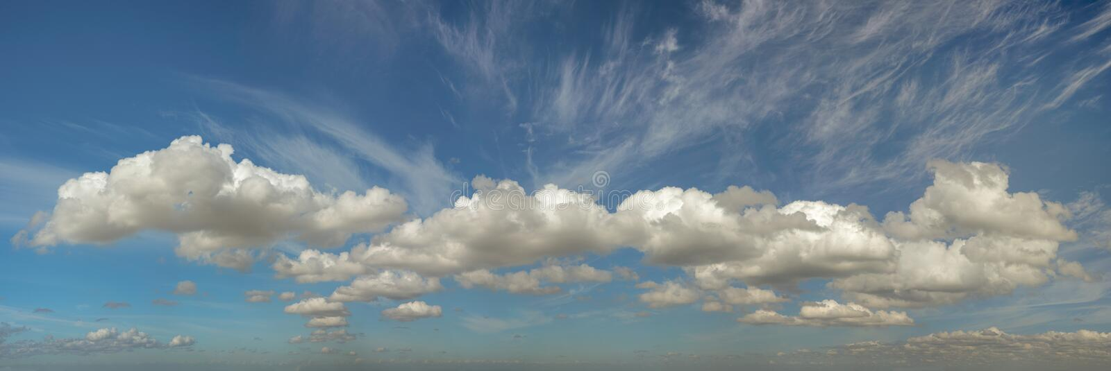Clouds formation with feathered streaks panorama. A panorama of moody cloud formation with high altitude feathered cloud above stock photos
