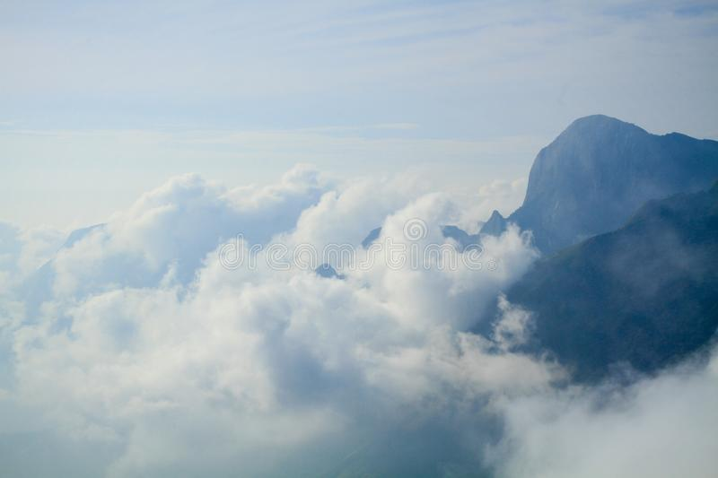 Clouds Formation on Top of Mountain Photography royalty free stock images