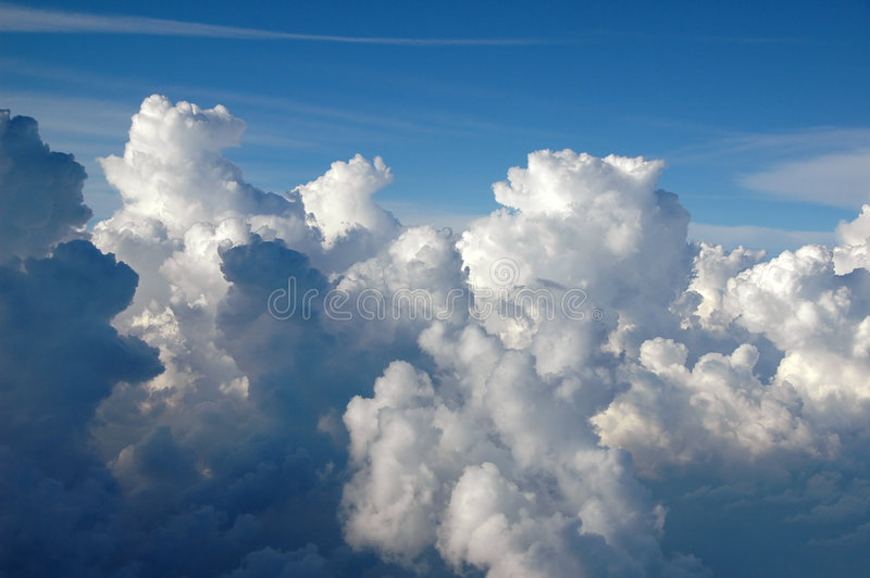 Clouds forming a massive storm stock photos