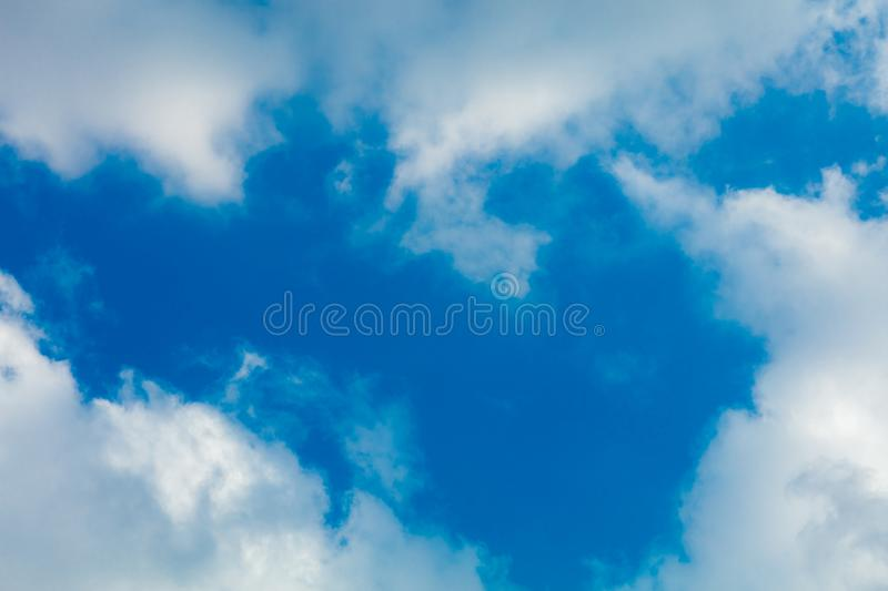 Clouds frame in sky. Dramatic cloudscape and sunlight jet view background royalty free stock photos