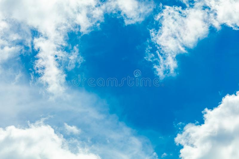 Clouds frame in sky. Dramatic cloudscape and sunlight jet view background stock image