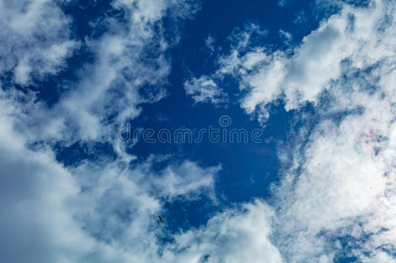 Clouds frame in sky. Dramatic cloudscape and sunlight jet view up stock image