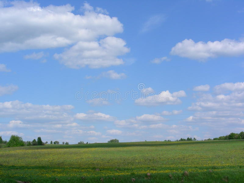 Clouds go over the field royalty free stock image