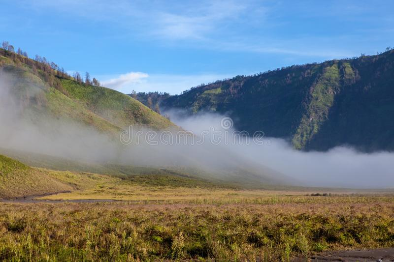 Clouds in green valley of Tengger caldera near. Clouds in green valley of Tengger caldera near Bromo volcano at Java island in Indonesia. Version 2 stock images