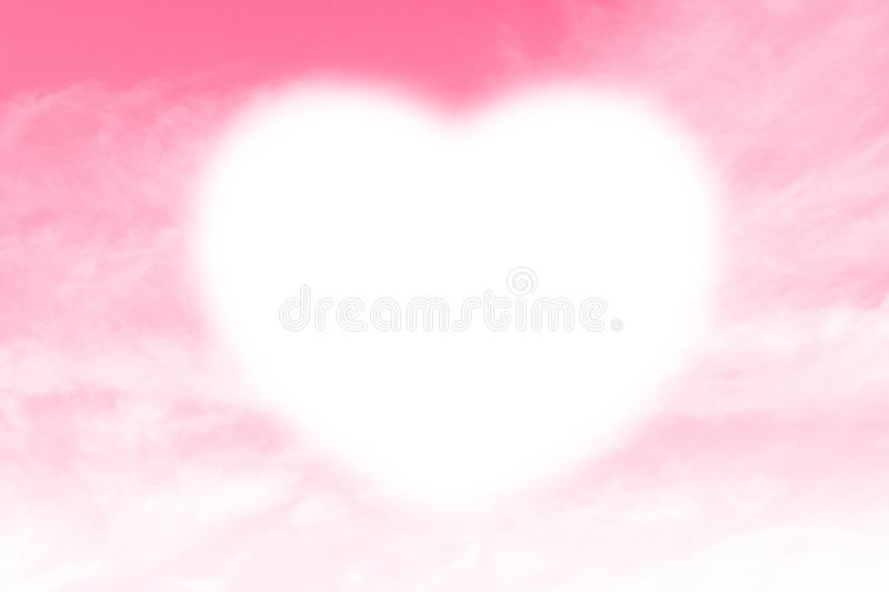 Clouds Heart shape white soft on Sky Pink background, Heart-shaped on sky for design valentine greeting cards copy space message stock photo