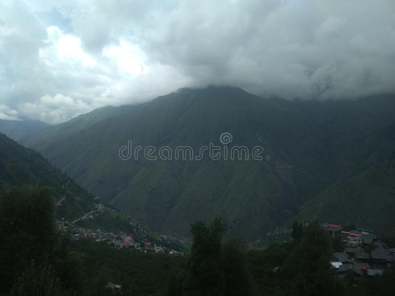 Clouds in Hill area along with waterfall and river view. Clouds in hill area and beautiful scenic beauty of hilly area. Also there is present beautiful river stock photography