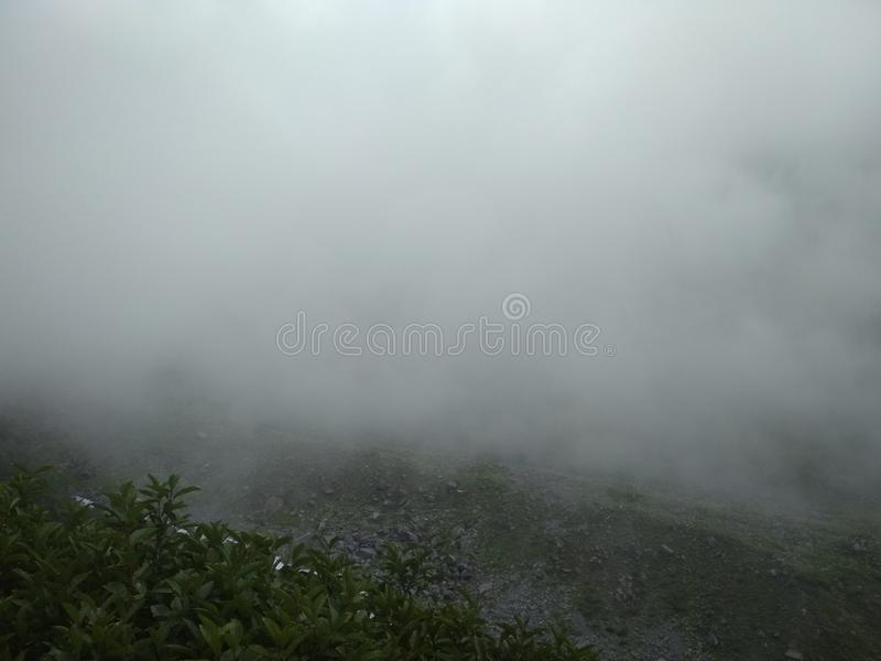 Clouds in Hill area along with waterfall and river view. Clouds in hill area and beautiful scenic beauty of hilly area. Also there is present beautiful river stock image