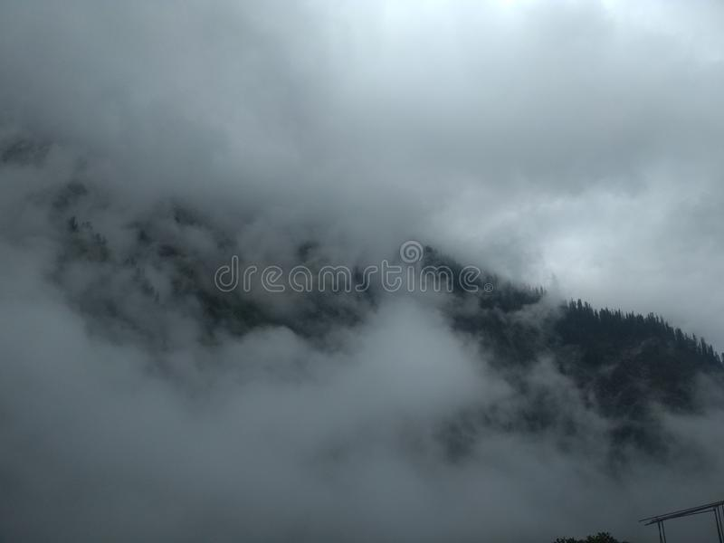 Clouds in Hill area along with waterfall and river view. Clouds in hill area and beautiful scenic beauty of hilly area. Also there is present beautiful river stock photos