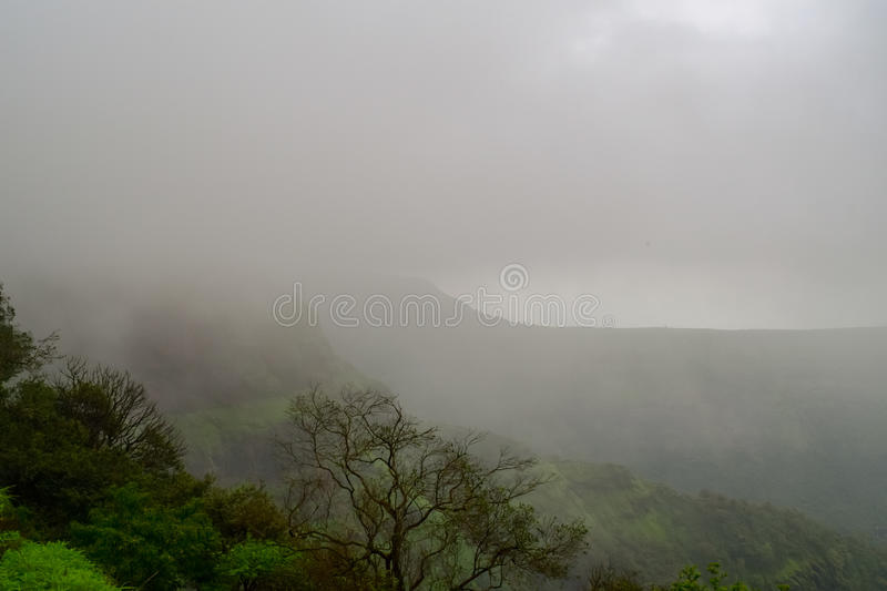 Clouds hovering in Matheran hill station of Raigad district Maharashtra. Nestled in Sahyadri range of western ghat India stock photography