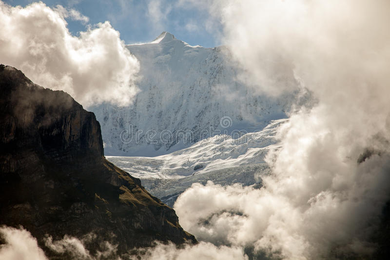 Clouds, ice and snow caps on Eiger,near Grindelwald, Switzerland. Clouds, ice and snow caps on Eiger,near Grindelwald Switzerland royalty free stock photo