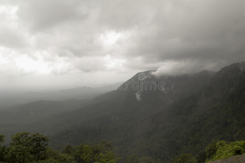 Clouds kissing the mountains stock photography