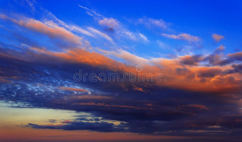 Clouds lit by the setting sun stock photo