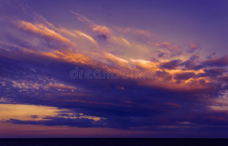 Clouds lit by the setting sun royalty free stock photography