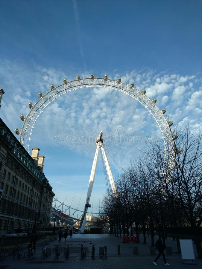 Clouds and London Eye stock photos