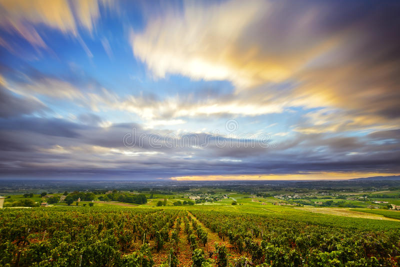 Clouds in long exposure at sunrise time over vineyards of Beaujolais, France royalty free stock image