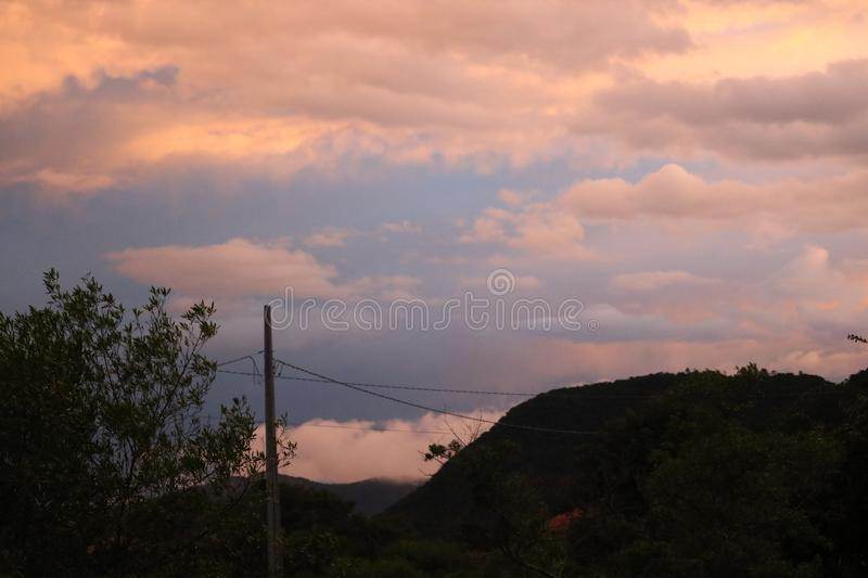 Clouds on mountain city sunset beach royalty free stock photography