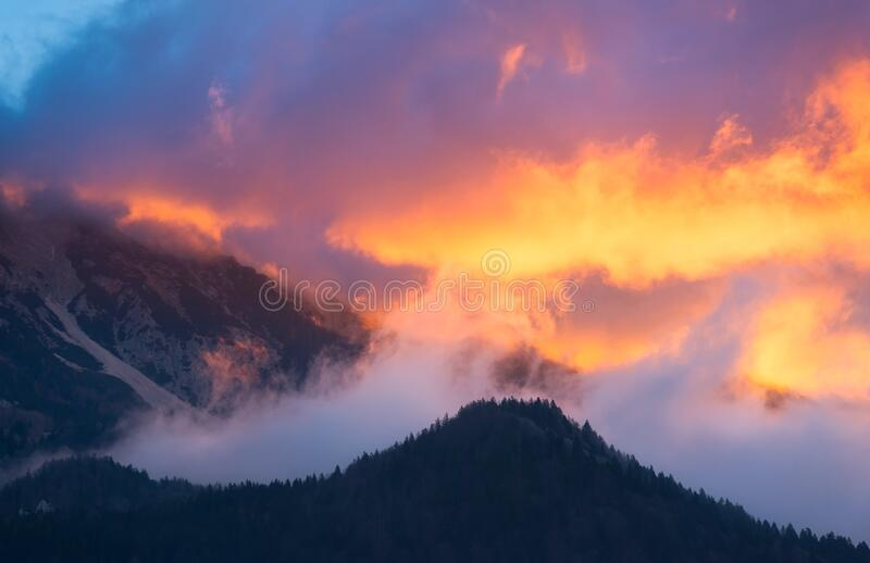 Clouds and mountains stock photography