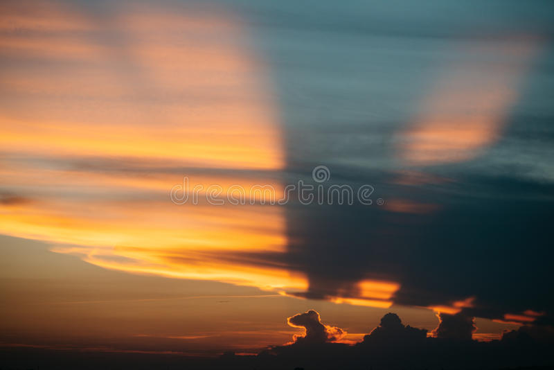 Clouds, multicolored sunset stock images