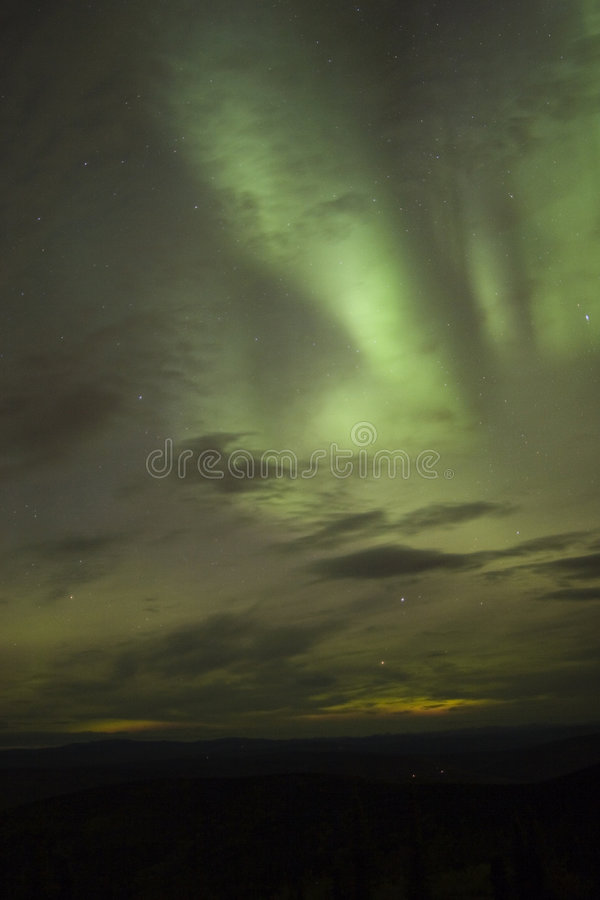 Clouds and northern lights royalty free stock photography