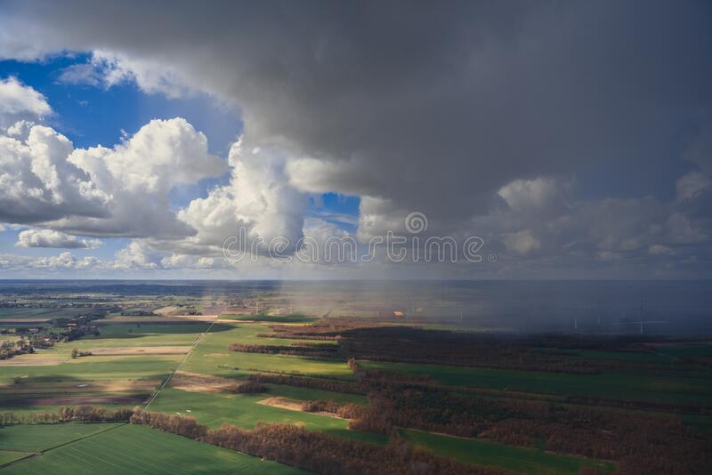 Clouds over agricultural fields royalty free stock photos