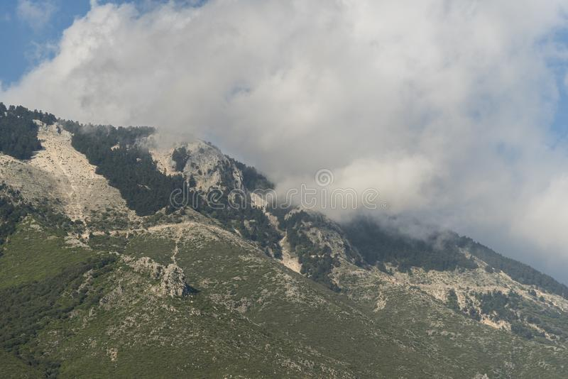Clouds over Ainos Oros mountain southern Kefalonia. Kefalonia is an island in the Ionian Sea, west of mainland Greece. Its marked by sandy coves and dry rugged royalty free stock photography