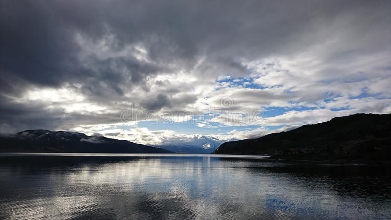 Clouds over the fjord royalty free stock image