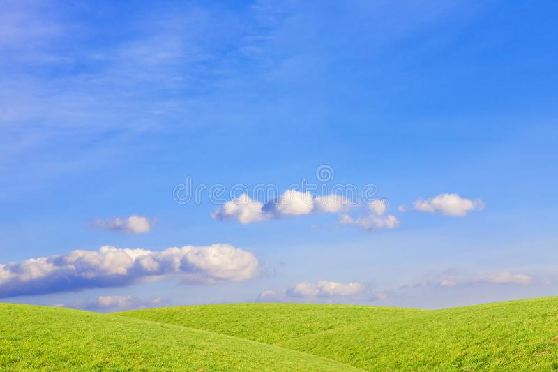 Clouds over green, grassy hills. Rural landscape. royalty free stock photos