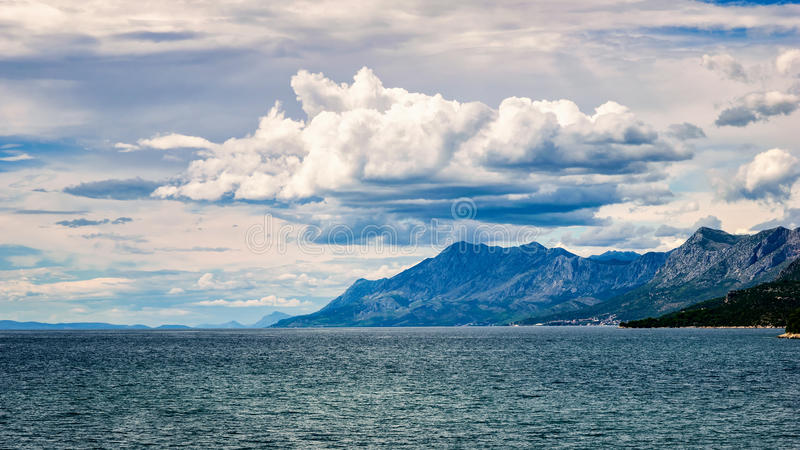 Clouds over the hills by the Adriatic sea in Croatia in summer stock image