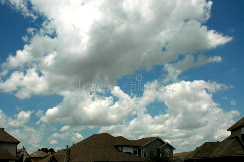 Clouds Over Houses Free Stock Photography