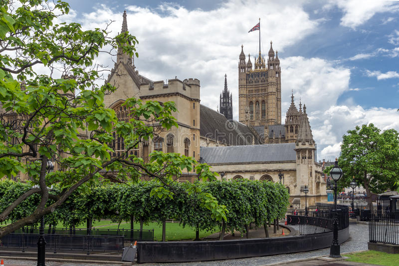 Clouds over Houses of Parliament, Palace of Westminster, London, England. Great Britain royalty free stock image