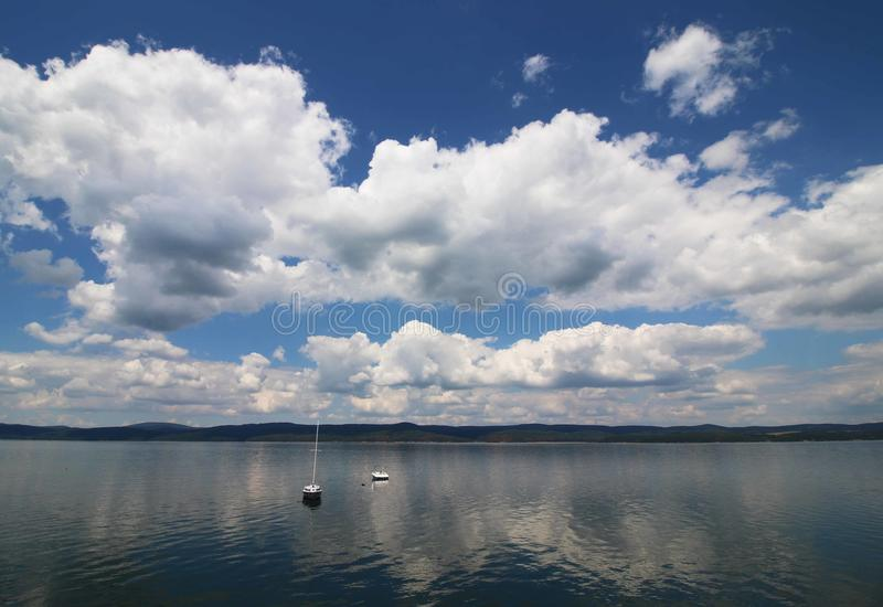 Clouds over the lake royalty free stock image