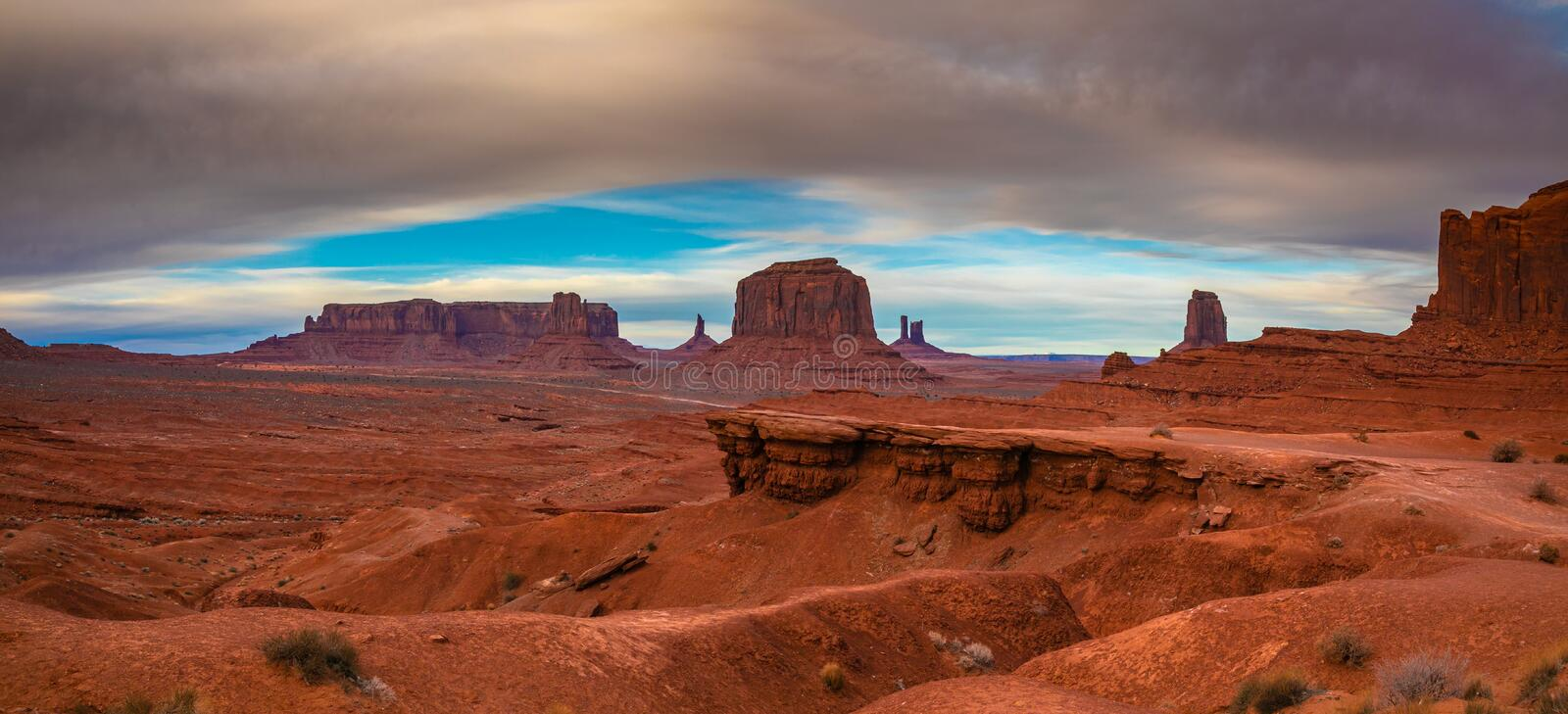 Clouds over Monument Valley, Navajo Land, Utah, USA. A panoramic photo of Monument Valley in a stormy weather. Navajo Land, Utah, USA stock photo