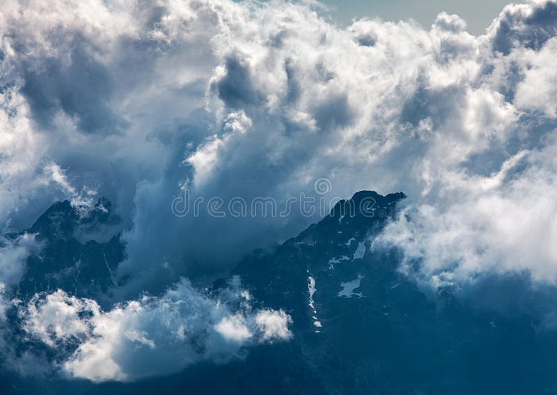 Clouds Over The Mountains Peaks Stock Photography