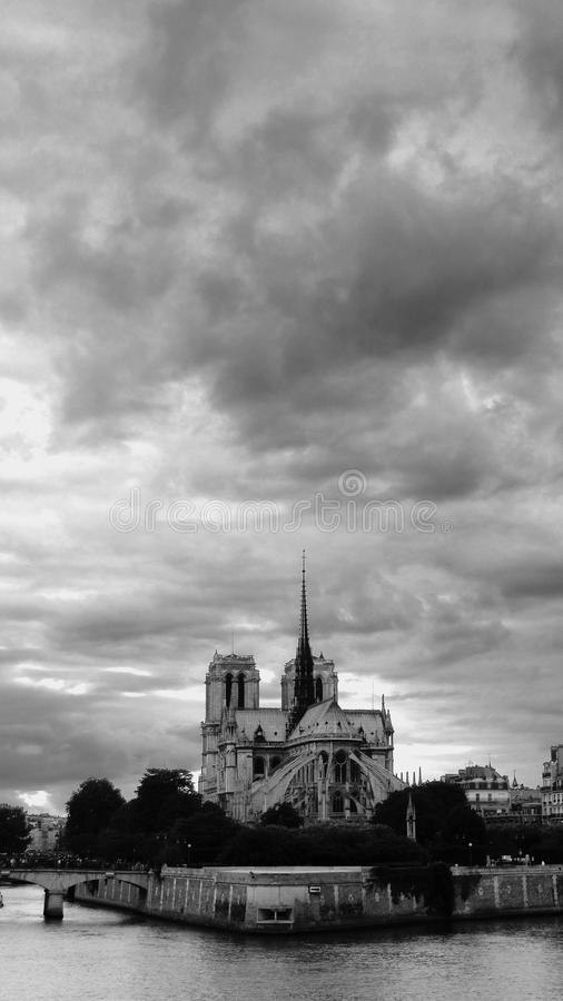 Clouds over the Notre Dame de Paris cathedral stock photography