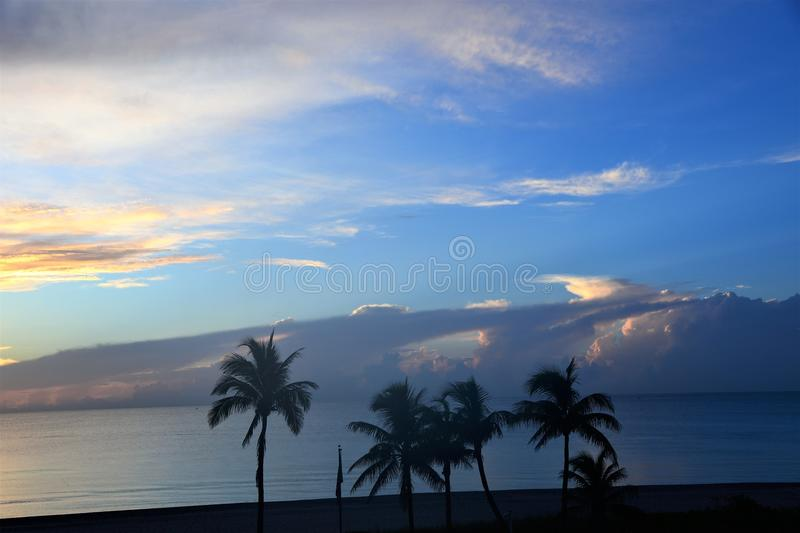 Clouds over the ocean horizon provide depth to a watery landscape stock photography
