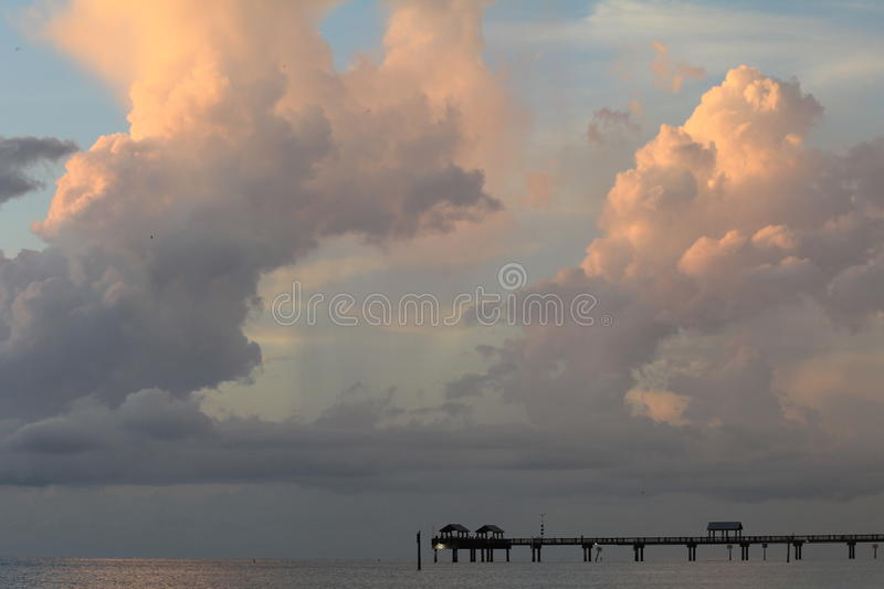 Clouds over pier in Clearwater royalty free stock photos