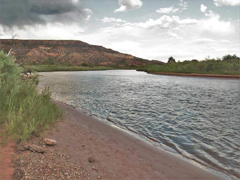 Clouds over Rio Chama near Abiquiu stock photography